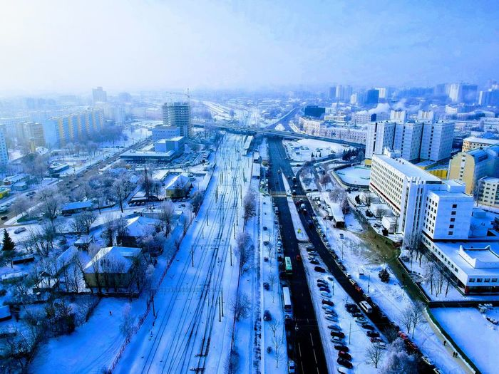 Transportation City Sky Mode Of Transportation No People Nature High Angle View Built Structure Architecture Cityscape Cold Temperature Building Exterior Winter Railroad Track Rail Transportation Blue Outdoors Road Snow Track