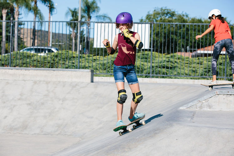 Full length of boy skateboarding on skateboard