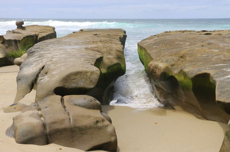 Waves through rocks at La Jolla beach California Dreamin La Jolla Beach Beach Beauty In Nature Day Horizon Over Water Nature No People Outdoors Rock - Object Scenics Sea Sky Tranquil Scene Tranquility Water