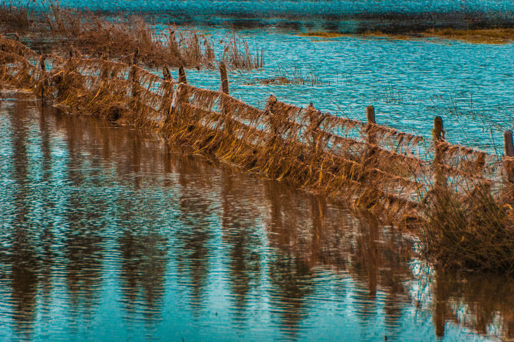 Limits... Edge EyeEmNewHere SC Beauty In Nature Blue Day High Angle View Lake Landscape Nature No People Non-urban Scene Outdoors Reflection Rippled River Scenics - Nature Textured Effect Tranquil Scene Tranquility Travel Destinations Water Waterfront Wood - Material Wooden Post