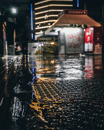 Wet road in city during rainy season at night