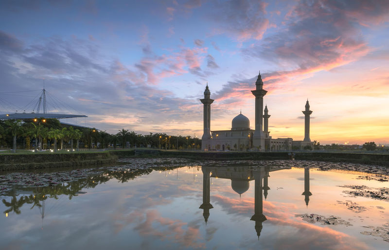 View and reflection of Bukit Jelutong Mosque with purple lotus in the lake during sunrise Architecture Bridge - Man Made Structure Cloud - Sky Lake And Ponds Landscape Majestic Sunrise Mecca Medina Nature Outdoors Place Of Worship Reflections Shah Alam Mosque Sky Stunning Clouds Sunrise Sunset Travel Water