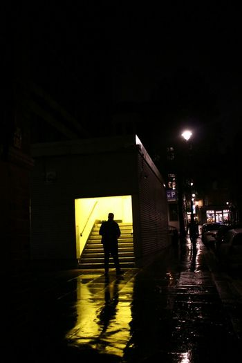 zero dark Streetphotography Street Nightphotography Night Lights Yellow City Full Length Silhouette Standing Architecture Sky Built Structure RainDrop Rainy Season Wet EyeEmNewHere Summer Exploratorium #FREIHEITBERLIN The Street Photographer - 2018 EyeEm Awards The Creative - 2018 EyeEm Awards