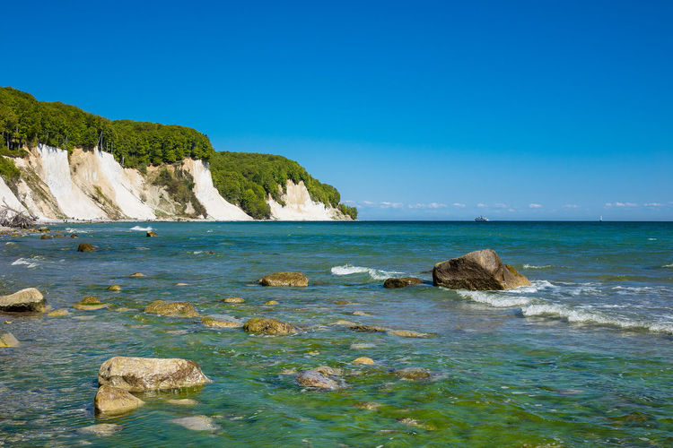 Baltic Sea coast on the island Ruegen, Germany Baltic Sea Chalk Cliffs Holiday Relaxing Trees Beauty In Nature Blue Cloud - Sky Coast Day Horizon Over Water Journey Nature No People Outdoors Ruegen Sea Shore Sky Tourism Tranquil Scene Travel Destinations Vacation Water White Cliffs