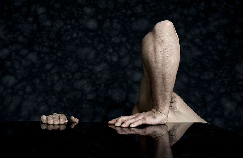 Cropped image of man on table