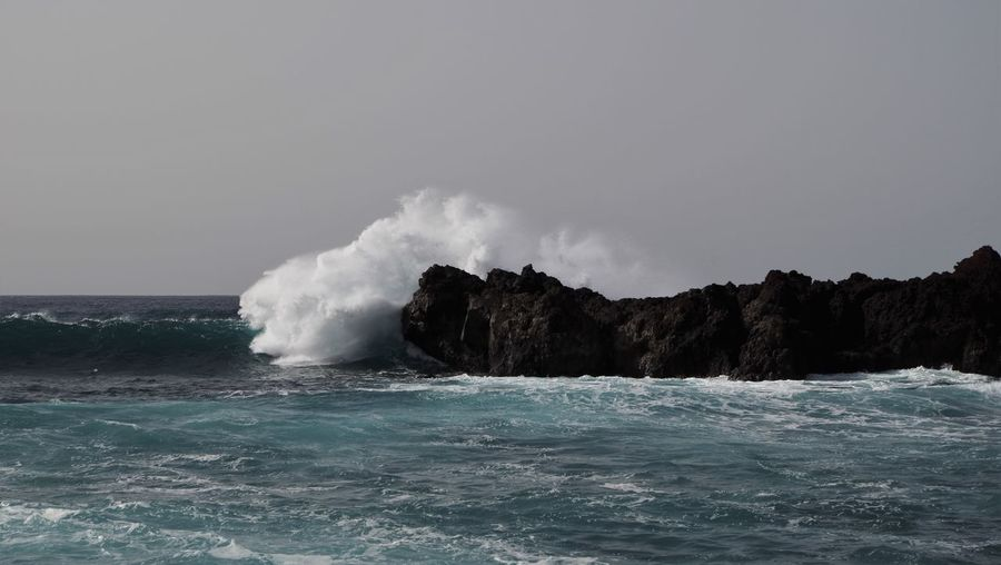 Wave breaking at El Golfo, Lanzarote. Beauty In Nature Breakwater Canary Islands Coast Crashing Waves  Crest Cyclone Day El Golfo Horizon Over Water Landscape Lanzarote Nature Outdoors Scenics Sea Shore SPAIN Storm Cloud Water Waterfront Wave Waves Waves And Rocks Waves Crashing
