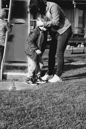 Outdoors Blackandwhite People Playground Equipment Playground Child Boy Playing Woman Motherandson  Mother