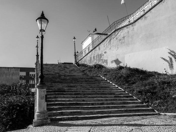 "they meet at these steps. she at bottom and he upon. Suddenly she begins levitating up, straight to him, without touching the steps. ""What is happening ?! she asks, to which he respond "" Rest Darling! is only my heart pulling you to me"". Taking Photos Street Photography Monochrome Blackandwhite Photography Blackwhitephotography Youinlisbon Click Saudade"
