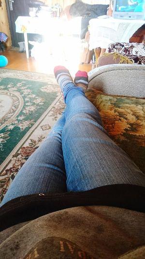 Low Section Human Leg Sitting Shoe Jeans Close-up