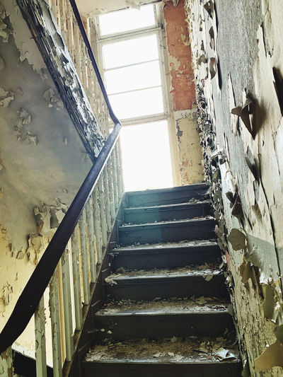 Low angle view of staircase in old building