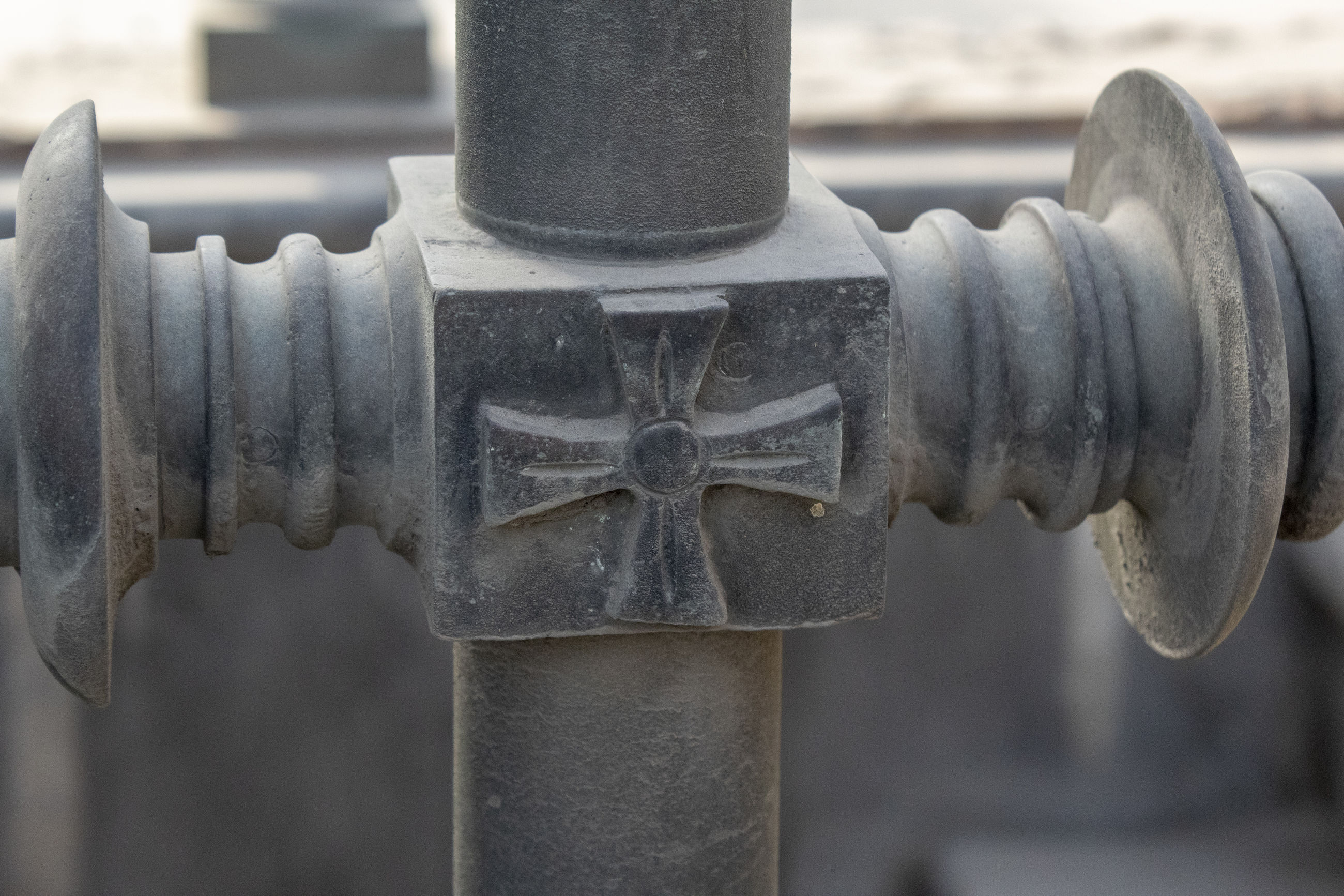 metal, close-up, no people, focus on foreground, day, cross, outdoors, pattern, architecture, old, design, cemetery, safety, security, protection, grave, shape, machinery, barrier, solid, machine valve