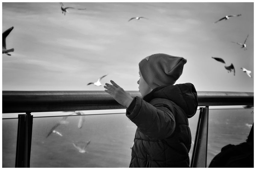 """""""Boat trip"""" Boat Trip Kid On A Boat Blackandwhite Blackandwhite Photography Blackandwhitephotography Blackandwhitephoto Black And White Black And White Photography EyeEm Best Shots - Black + White Bandw Texel  Texel, The Netherlands Warm Clothing Sky Cloud - Sky"""