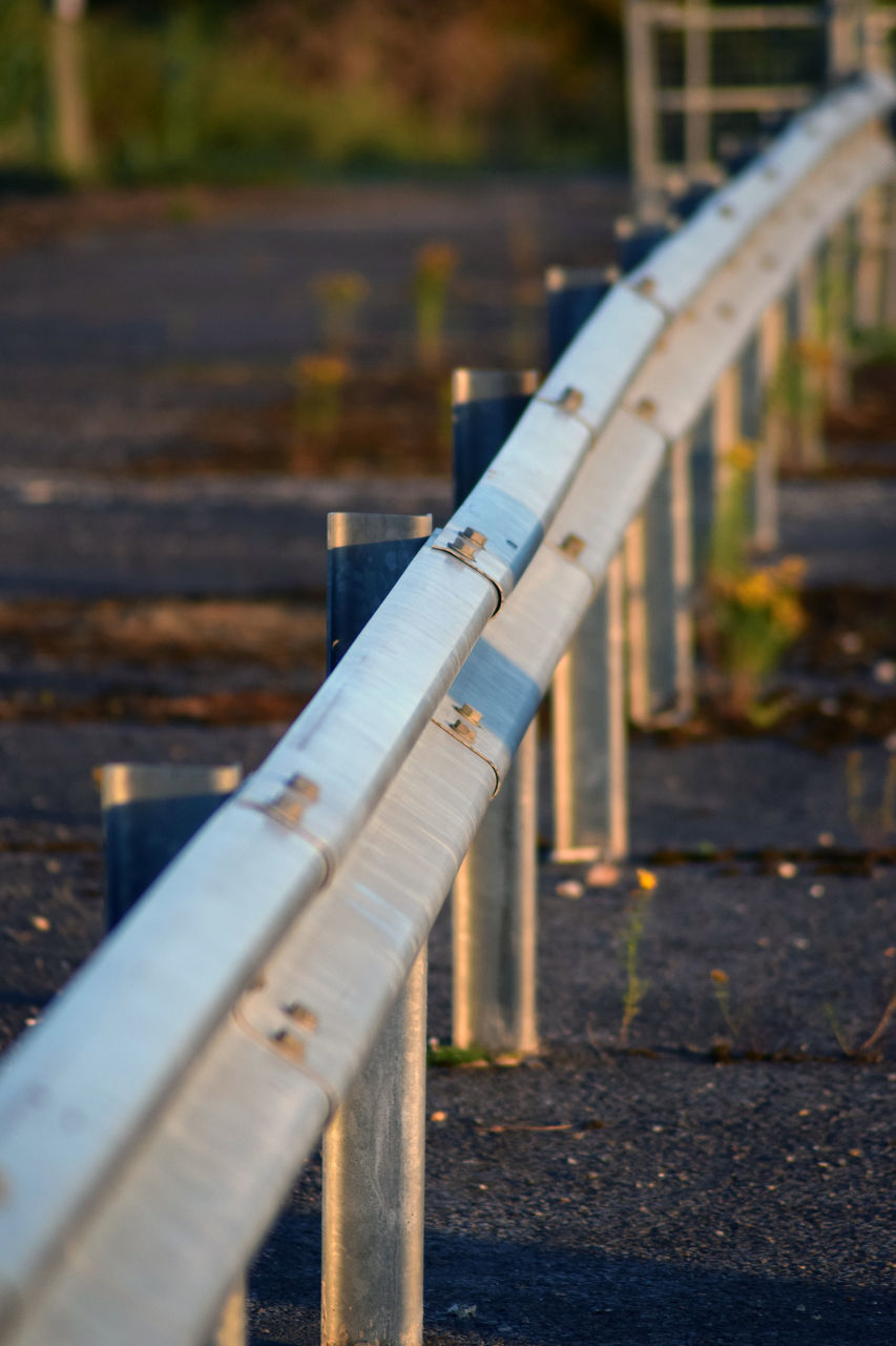 day, selective focus, nature, no people, metal, focus on foreground, outdoors, railing, connection, architecture, built structure, bridge, close-up, bridge - man made structure, wood - material, in a row, water, footpath, sunlight