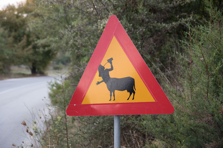 Warning: Beware of centaur! Attention Animal Themes Beware Centaur Close-up Day Nature Outdoors Road Road Sign Tree Triangle Shape Warning Yellow