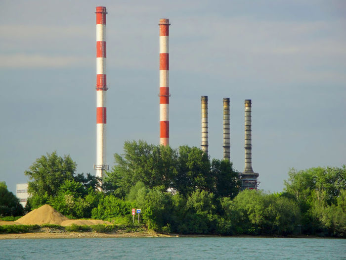 Heating plant across the river Chimney Day Ecological Ecology Factory Heating Plant Industry No People Polution River Sky Water Waterfront