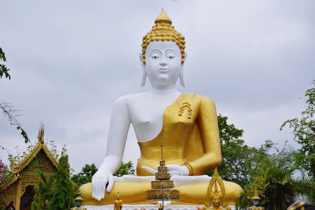 Statue Religion Sculpture Male Likeness Human Representation Spirituality Idol Golden Color Low Angle View Gold Colored Place Of Worship Sky No People Outdoors Day