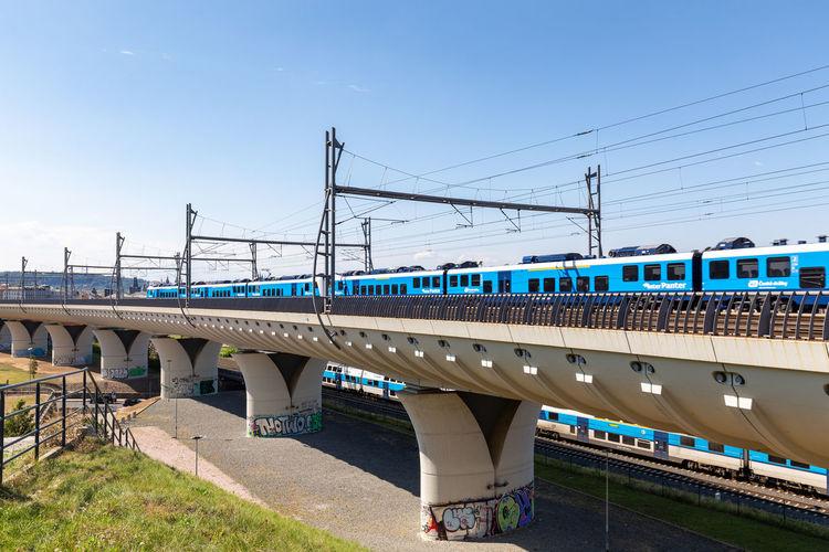 Train in bridge against sky