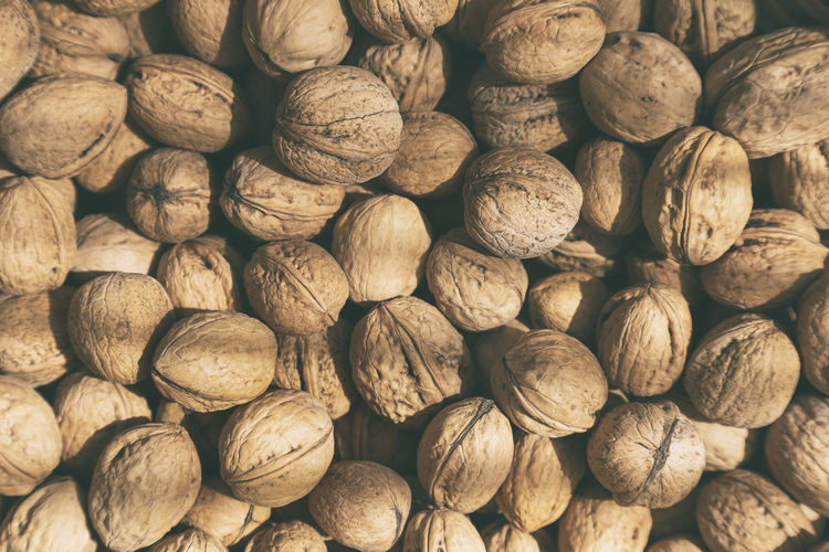 Lots of organic walnuts, full frame. healthy eating concept.