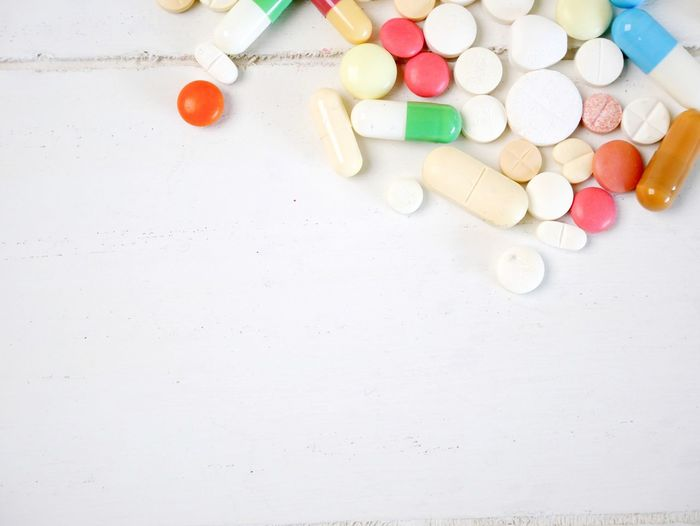 Pills and capsules on white wood with copy space Nobody Wood EyeEm Selects Medicine Pill Dose Indoors  No People Healthcare And Medicine Capsule Choice Multi Colored High Angle View Prescription Medicine Nutritional Supplement Close-up Copy Space Variation