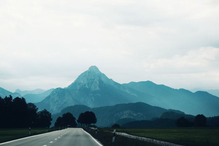 mountain and road EyeEm Selects Outdoors Vocation Travel Edventure  Beauty In Nature Background Landscape Roadtrip Alps AlpsMountain Summer Color View Pattern Tree Mountain Road Rural Scene Sky Landscape Cloud - Sky Mountain Range Fog Foggy Weather Empty Road Mountain Road Cultivated Land