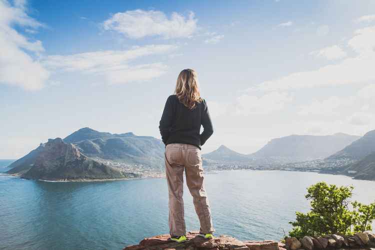 Beauty In Nature Casual Clothing Cloud - Sky Full Length Getting Away From It All Hout Bay Idyllic Leisure Activity Long Hair Mountain Mountain Range Mountains Nature Rear View Relaxation Scenics Sea And Sky Sky Tranquil Scene Tranquility View Views Water Woman Young Adult