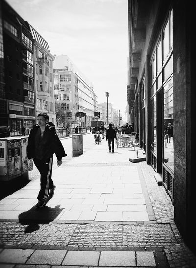 Young man, old city... Architecture City Building Exterior Street Adult Built Structure City Life People Adults Only Only Men Outdoors Day One Person Streetphotography Streetphotographers Street Life The Street Photographer - 2017 EyeEm Awards Bnw_planet Bnw_collection Neighborhood Map Berlin Love Discover Berlin