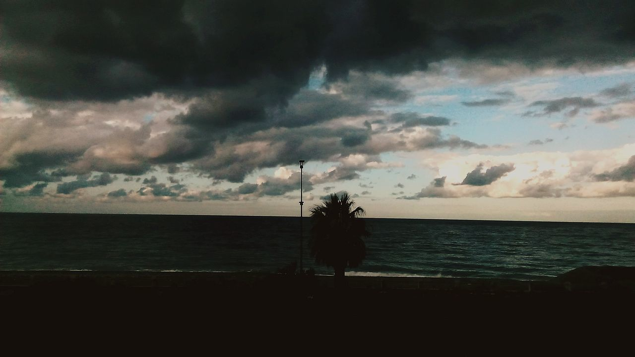 sea, sky, cloud - sky, horizon over water, water, nature, scenics, beauty in nature, sunset, silhouette, tranquil scene, beach, tranquility, outdoors, storm cloud, no people, day