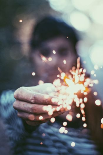 Human Hand Real People Outdoors Focus On Foreground One Person Illuminated Leaf Close-up Autumn Christmas Human Body Part Sparkler People Hope