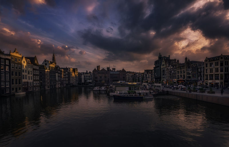 Amsterdam EyeEm Best Shots Remo SCarfo Sky And Clouds Tadaa Community Architecture Building Exterior Built Structure Canal City Cityscape Cloud - Sky Day Dutch Holland Nautical Vessel No People Outdoors River Sky Sunset Water Waterfront