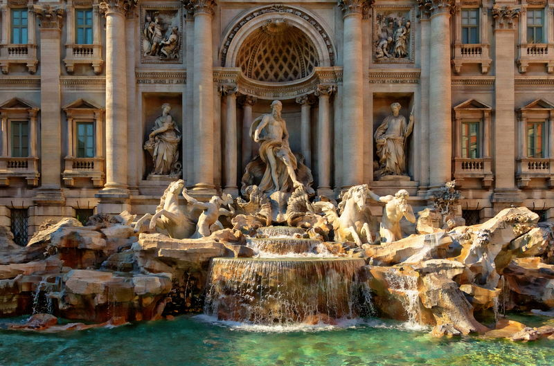 The Trevi Fountain in Rome, Italy Rome Trevi Fountain Architectural Column Architecture Building Exterior Built Structure Day Fountain History Human Representation Italy No People Outdoors Sculpture Statue Tourism Travel Travel Destinations Water