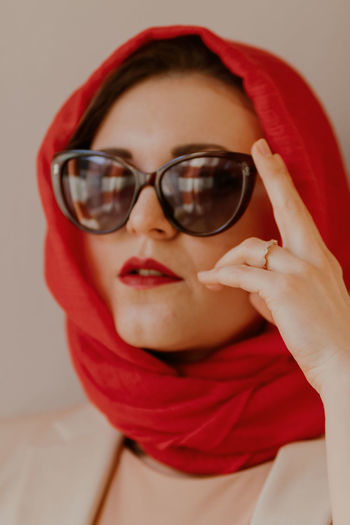 Close-up portrait of young woman with sunglasses