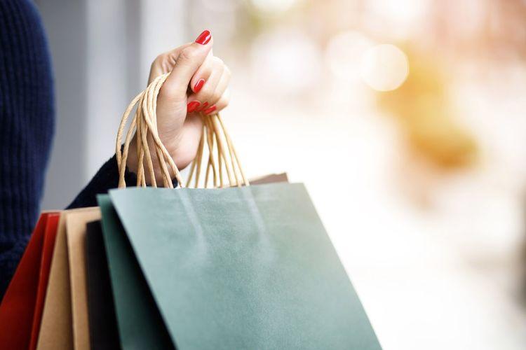 Close-up of woman holding umbrella at store