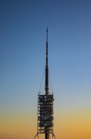 Low angle view of communication tower against clear sky
