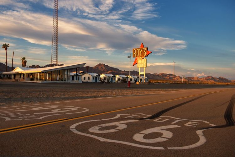 Scenery Motherroad Low Angle View Icon Logo Street Town Sign Motel Desert Mojave Landmark Historic Hotel Cafe Road Marker Route 66 Roy's Roy's Motel And Cafe California Amboy Sky Road Marking Road Cloud - Sky Communication Road Sign Day Sunset California Dreamin