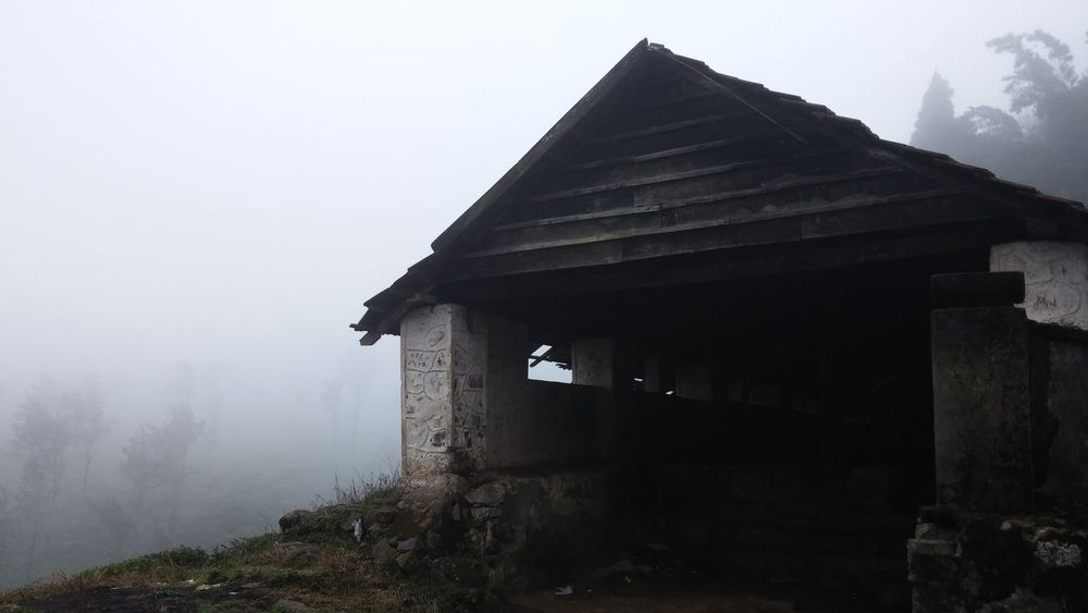 Dilapidated Car parking Space in Hill Station on a Foggy Day Architecture Building Building Exterior Built Structure Chembrapeak Dilapidated Exterior Foggy Day Foggy Morning House Hut Low Angle View Old Parking Garage Place Of Worship Waynad Waynad Kerala