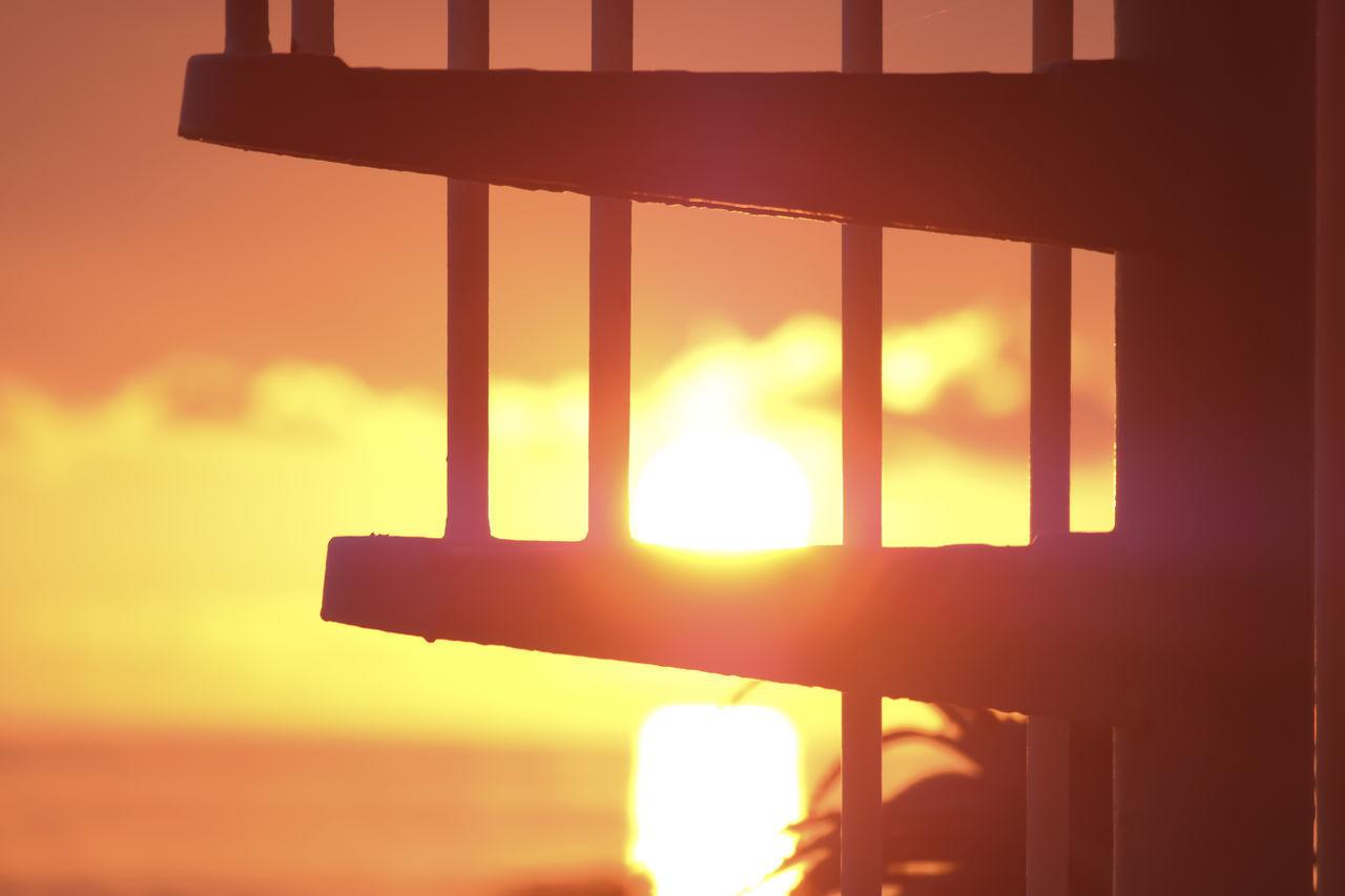 CLOSE-UP OF ILLUMINATED ORANGE SUNSET SKY