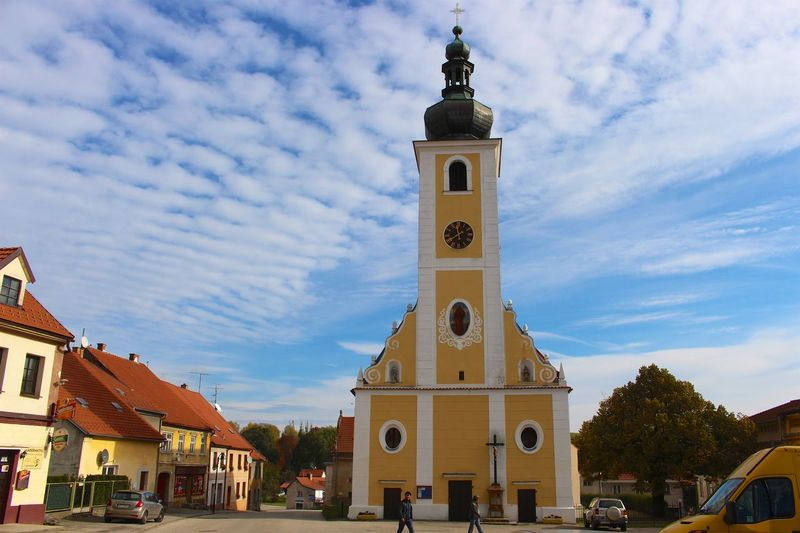 The yellow church in the little village Architecture Building Exterior Church Czech Republic Place Of Worship Religion Skies Sky Spirituality Travel Traveling Village Yellow