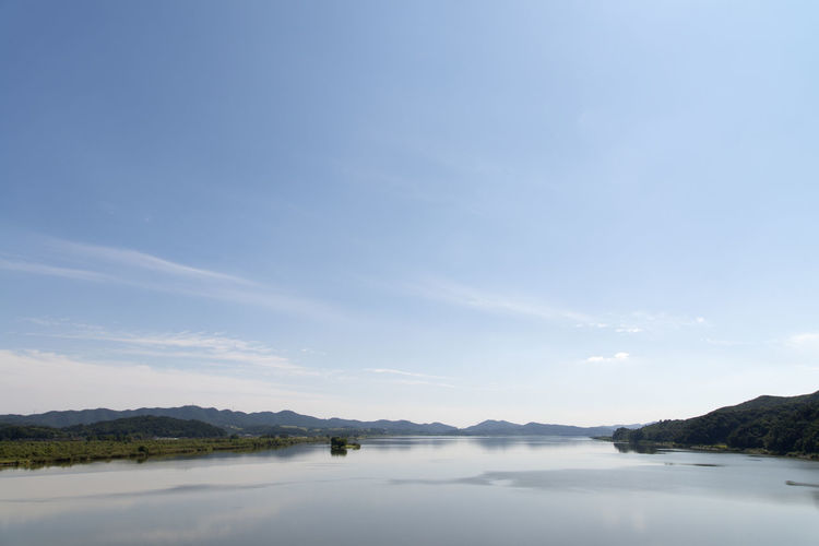 river view at Wungpodaegyo Bridge of Geumgang River in Iksan, Jeonbuk, South Korea Geumgang Geumgang River On The Bridge Beauty In Nature Blue Cloud - Sky Day Lake Mountain Nature No People Outdoors River Scenics Sky Tranquil Scene Tranquility Tree Water Waterfront