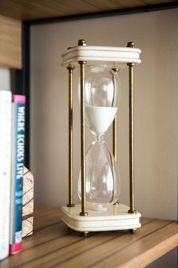 Hourglass On Wooden Shelf