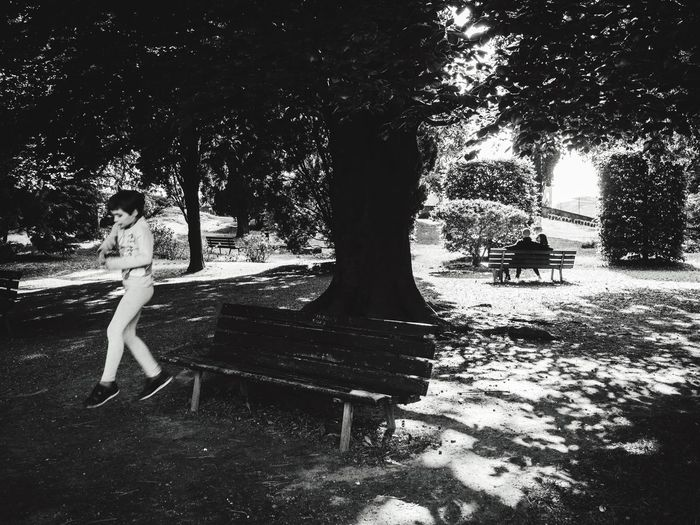 Skip a beat // Bergamo Alta // Apr'17 Tree Nature Real People Sitting Growth Young Women Leisure Activity Outdoors Tree Trunk Young Adult Day Full Length Women Beauty In Nature People Streetphotography Reportage Monochrome Blackandwhite Leap Bench Italy Bergamo The Street Photographer - 2017 EyeEm Awards