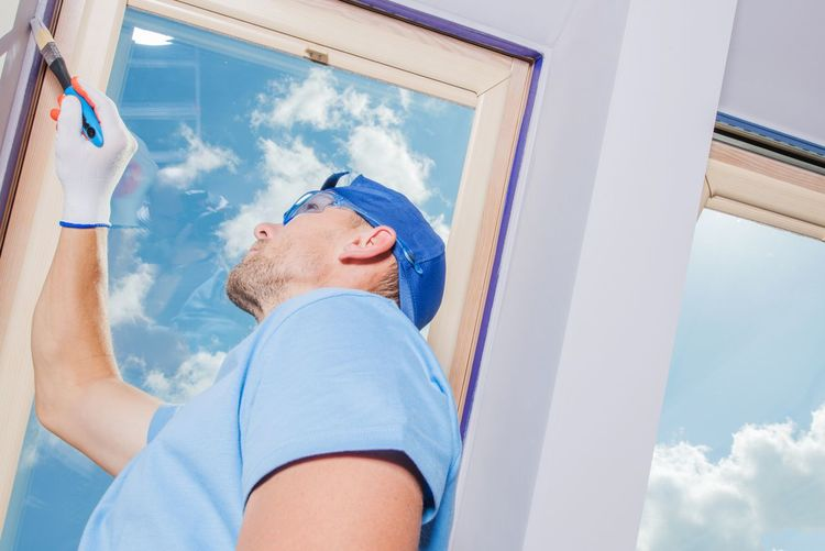 Low angle view of man painting wall at home