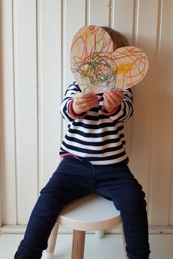 Valentine Valentine's Day  Love Present Gift Heart Heart Shape Art And Craft Painting Multi Colored Child Childhood White Background White Wall Sitting Chair Productivity Interior Design Large Group Of Objects Drawing Pens Toddler  Boy Growing Up Happiness Holding Heart Holding Paper Silouette Casual Clothing Happiness
