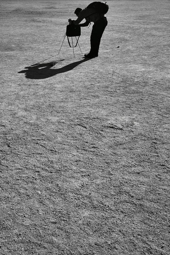 Black and white photo of a man setting up camera on tripod Low Section Real People One Person Human Body Part Human Leg Body Part Leisure Activity Day Sport Men Lifestyles Nature Shadow Land Sunlight Motion Outdoors Unrecognizable Person Skill  Human Limb Blackandwhite Light And Shadow Selfie Preparation  Tripod