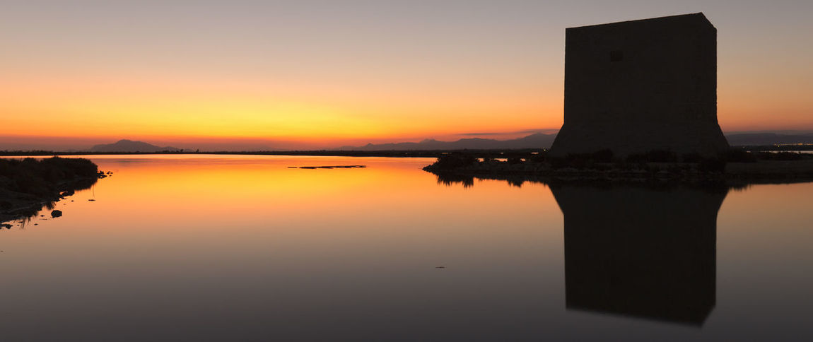 Tower of Tamarit at sunset in the town of Santa Pola, province of Alicante in Spain Alicante European  SPAIN Santa Pola Spanish Beauty In Nature Dawn Lake Nature No People Orange Color Outdoors Reflection Scenics Silhouette Sky Sun Sunset Tamarit Tower Of Tamarit Tranquil Scene Tranquility Water Waterfront