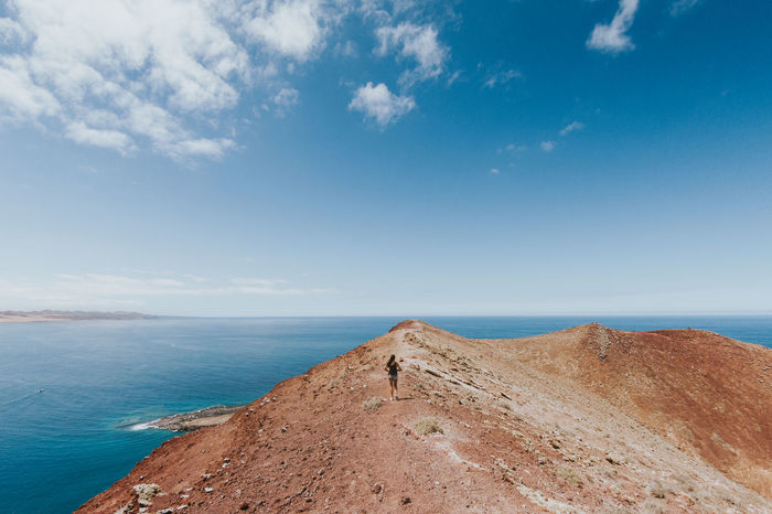 Beauty In Nature Blue Canary Islands Cloud - Sky Day Girl Horizon Over Water La Graciosa Landscape Landscape_Collection Landscape_photography Lanzarote Mountain Nature Nature Ocean View Outdoors Scenics Sea Sky Tranquil Scene Tranquility View Women Women Around The World