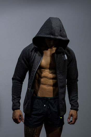 Close-Up Of Muscular Man In Hood - Clothing