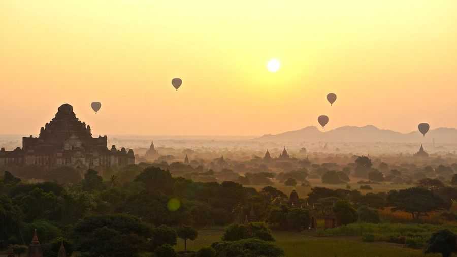 Ancient Civilization Balloons Over Pagodas In Bagan Cultures Hot Air Balloon Mid-air Myanmar Sunrise Tourism Traveling Vacation