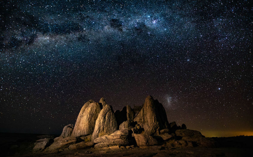 Majestic View Of Rock Formation Against Star Field At Night