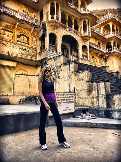 Woman Standing At Amber Fort In City Against Sky
