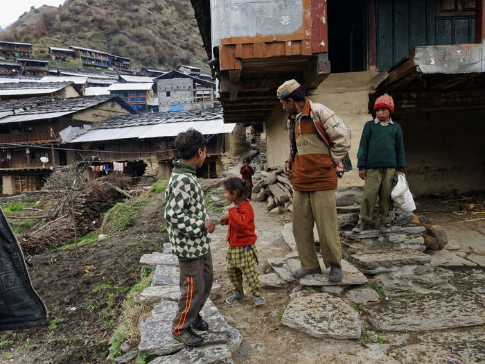 Family out on the town Agriculture Architecture Building Exterior Built Structure Day Full Length Lifestyles Men Outdoors People Real People Togetherness Traditional Clothing